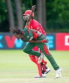 ICC World T20 Qualifier - GROUP B MATCH - CANADA V KENYA at Watsonians CC, Edinburgh - Kenya's Nelson Odhiambo bowls past Canada's Ruvindu Gunasekera — credit @ICC/Donald MacLeod - 10.07.15 - 07702 319 738 -clanmacleod@btinternet.com - www.donald-macleod.com