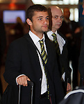 Shaun Maloney waiting in the queue for check-in