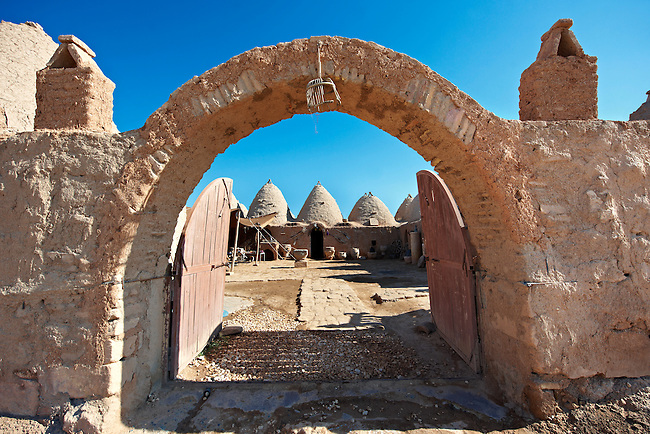 """Pictures of the beehive adobe buildings of Harran, south west Anatolia, Turkey.  Harran was a major ancient city in Upper Mesopotamia whose site is near the modern village of Altınbaşak, Turkey, 24 miles (44 kilometers) southeast of Şanlıurfa. The location is in a district of Şanlıurfa Province that is also named """"Harran"""". Harran is famous for its traditional 'beehive' adobe houses, constructed entirely without wood. The design of these makes them cool inside. 10"""