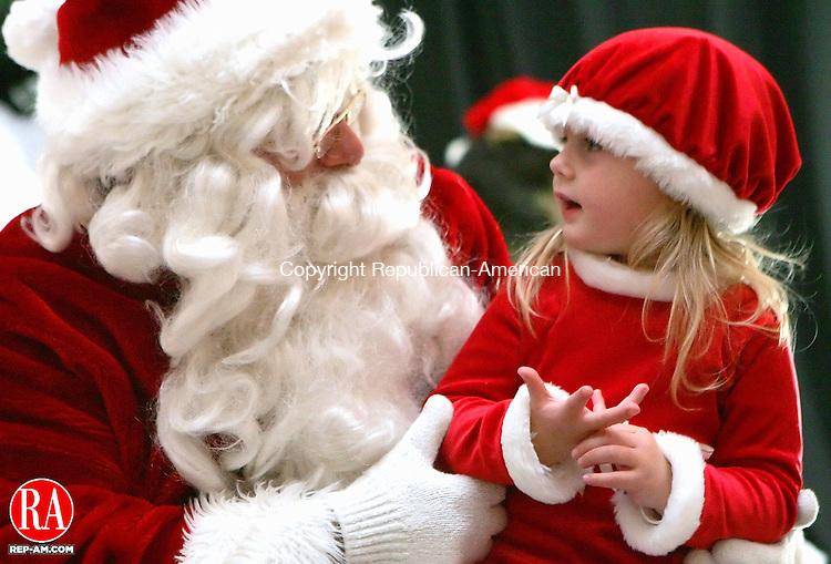 "WASHINGTON, CT - 09 DECEMBER 2005 -120905J06---Mari Leonard, 2, of Washington tells Santa what she wants for Christmas during the 15th annual ""Holiday in the Depot"" Friday in Washington.  --  Jim Shannon Republican-American--Mari Leonard, Holiday in the Depot are CQ"