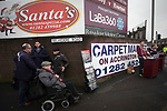 Programme sellers and fans pictured outside the stadium before Burnley hosted Everton in an English Premier League fixture at Turf Moor. Founded in 1882, Burnley played their first match at the ground on 17 February 1883 and it has been their home ever since. The visitors won the match 5-1, watched by a crowd of 21,484.