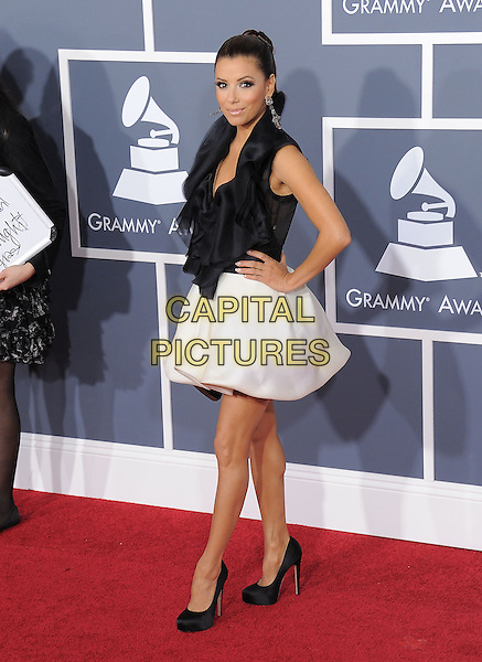 EVA LONGORIA .attending The 53rd Annual GRAMMY Awards held at The Staples Center in Los Angeles, California, USA,.February 13th 2011..arrivals grammys full length black dress top white skirt hands on hips shoes sleeveless ruffle                                                                   .CAP/RKE/DVS.©DVS/RockinExposures/Capital Pictures.