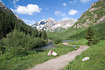 Hiking trail leading to the Maroon Bells, near Aspen, Colorado .  John leads hiking and photo tours throughout Colorado. .  John leads hikes and private photo tours in Boulder and throughout Colorado. Year-round.