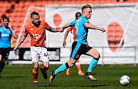 Fleetwood Town's Kyle Dempsey competes with Blackpool's Jay Spearing<br /> <br /> Photographer Richard Martin-Roberts/CameraSport<br /> <br /> The EFL Sky Bet League One - Blackpool v Fleetwood Town - Saturday 14th April 2018 - Bloomfield Road - Blackpool<br /> <br /> World Copyright &not;&copy; 2018 CameraSport. All rights reserved. 43 Linden Ave. Countesthorpe. Leicester. England. LE8 5PG - Tel: +44 (0) 116 277 4147 - admin@camerasport.com - www.camerasport.com