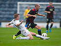 Raith Rovers' Paul Watson challenges Caley's James Vincent .