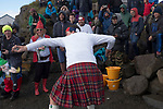 'Contestant in a kilt at the World Stone Skimming Championships, 2018' from Colin McPherson's project 'Treasured Island' part of the Document Scotland exhibition entitled 'A Contested Land' which will launch at the Martin Parr Foundation, Bristol, on 16th January, 2019. McPherson's work was made in 2018-2019 on Easdale, the smallest permanently inhabited Inner Hebridean island and looks at the historical legacy of the island, once world famous for its slate mining industry.<br /> <br /> Photograph © Colin McPherson, 2018 all rights reserved.