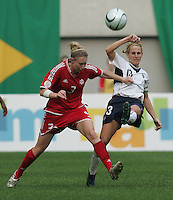 Nov 4, 2006: Seoul, South Korea:  USWNT forward (13) Kristine Lilly clears the ball away from Canadian midfielder (3) Melanie Booth while playing in the Peace Queen Cup final at Seoul World Cup Stadium. The United States defeated Canada, 1-0.