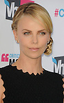 HOLLYWOOD, CA - JANUARY 12: Charlize Theron arrives at the 17th Annual Critics' Choice Movie Awards at Hollywood Palladium on January 12, 2012 in Hollywood, California.