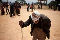 A survivor of Nepal earthquake goes back to his tent after receiving treatment at a medical camp at Sindhupalchok, outskirt of Kathmandu, Nepal. May 1, 2015