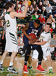 JANUARY 24, 2015 -- Wyatt Krogman #11 of Black Hills State reaches on Tyrone Marshall #24 of CSU-Pueblo during their Rocky Mountain Athletic Conference men's basketball game at the Donald E. Young Center in Spearfish, S.D. Saturday. At left is Riley Ryan of Black Hills State. (Photo by Dick Carlson/Inertia)