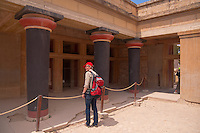German tourist standing in front of Knossos Palace Museum, Crete, Grece