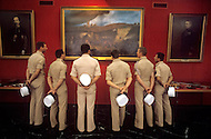 July, 1980, Aubagne, France, the French Foreign Legion Museum. Young legionnaires looking at paintings and old uniforms.
