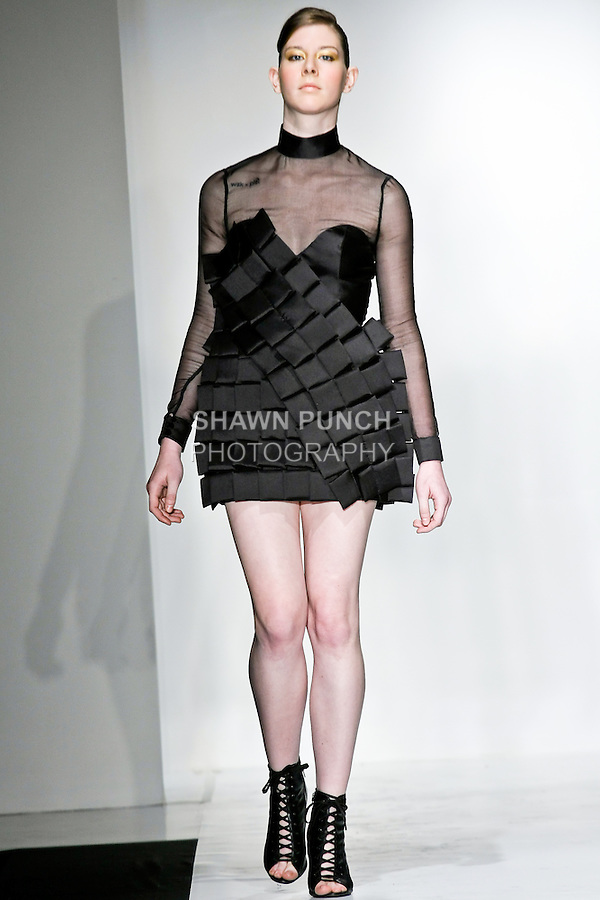 Model walks the runway in a  outfit, designed by  , during the Pratt Institute 2010 Fashion Show on May 13, 2010.