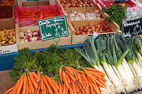 vegatable market with boxes of vegetables