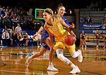 BROOKINGS, SD - NOVEMBER 1: Tylee Irwin #21 from South Dakota State gets a step past Coral Gillette #20 from the University of Mary during their exhibition game Thursday night at Frost Arena in Brookings. (Photo by Dave Eggen/Inertia)