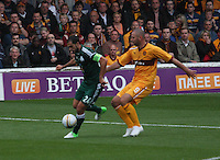 Loukas Vyntra being challenged by Michael Higdon in the Motherwell v Panathinaikos UEFA Champions League 3rd Qualifying Round 1st Leg match at Fir Park, Motherwell on 31.7.12.