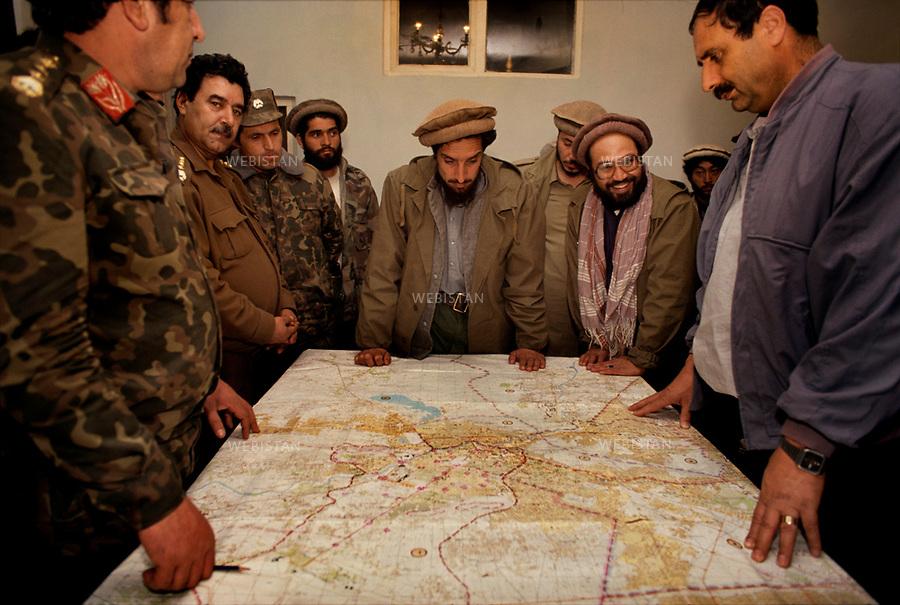 Afghanistan. Kabul. 1992. In the ministry of Interior, the commandant Massoud gathered his men and the generals and are looking on an Ordnance Survey map.<br /> <br /> Afghanistan. Kaboul. 1992. Au minist&egrave;re de l'Int&eacute;rieur, le commandant Massoud r&eacute;unit ses hommes et les g&eacute;n&eacute;raux autour d'une carte d'&eacute;tat-major.