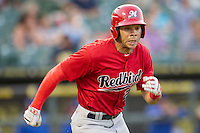 Memphis Redbirds outfielder Thomas Pham #27 runs to first base during the Pacific Coast League baseball game against the Round Rock Express on April 24, 2014 at the Dell Diamond in Round Rock, Texas. The Express defeated the Redbirds 6-2. (Andrew Woolley/Four Seam Images)
