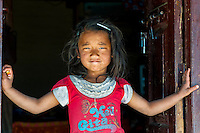 Young girl early in the morning as seen at a  village of the Annapurna range in the Himalayas of Nepal.
