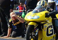 Sept. 22, 2012; Ennis, TX, USA: A crew member for NHRA pro stock motorcycle rider Karen Stoffer looks on during qualifying for the Fall Nationals at the Texas Motorplex. Mandatory Credit: Mark J. Rebilas-US PRESSWIRE