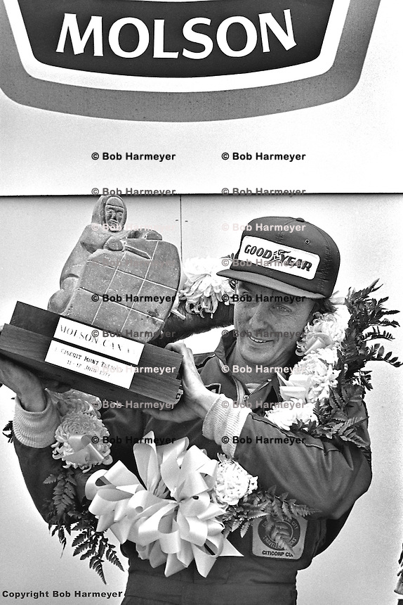 Tom Klausler driver of the Schkee Chevrolet Can-Am car, in victory lane after winning the 1977 SCCA Can-Am race at Le Circuit Mont Tremblant, near St. Jovite, Quebec, Canada.