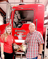 COURTESY PHOTO Pineville Mayor and volunteer firefighter Gregg Sweeten, right, is pictured with his daughter, Kalee. He recently won an essay contest in which he wrote about Kalee joining the volunteer fire department.
