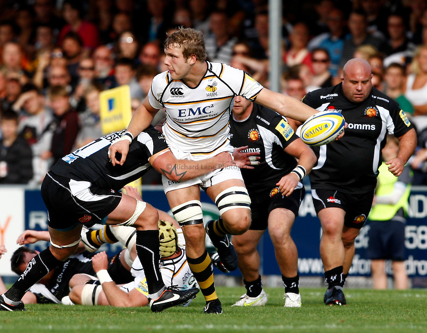 Photo: Richard Lane/Richard Lane Photography. Exeter Chiefs v London Wasps. Aviva Premiership. 25/09/2011. Wasps' Joe Launchbury offloads in the tackle.