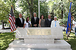 Nevada Sesquicentennial officials pose with the restored memorial during the USS Nevada Centennial of Launch ceremony at the Capitol, in Carson City, Nev., on Friday, July 11, 2014.<br /> Photo by Cathleen Allison
