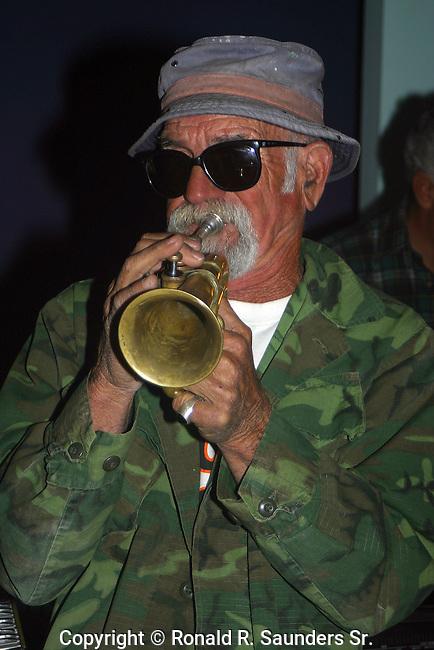 JAZZ MUSICIAN BLOWS HIS HORN