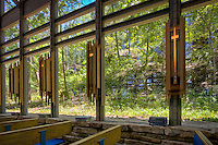 Thorncrown Chapel is located in Eureka Springs Arkansas.<br /> The chapel rises 48 feet into the sky with over 6,000 square feet of glass and 425 windows. Its dimensions are 24 feet by 60 feet. The chapel is made with all organic materials to fit its natural setting. The only steel in the structure forms a diamond shaped pattern in its wooden trusses. The building has a native flagstone floor surrounded with a rock wall which gives the feeling that the chapel is part of its Ozark hillside.