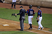 Umpire Sam Vogt stands in between Kane County Cougars catcher Wilson Contreras #19 and the pitcher after Contreras was hit by a pitch with coach Kenny Socorro looking on during a game against the Beloit Snappers May 26, 2013 at Fifth Third Bank Ballpark in Geneva, Illinois.  Beloit defeated Kane County 6-5.  (Mike Janes/Four Seam Images)