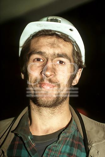 Slovakia. Miner wearing a white hard hat.
