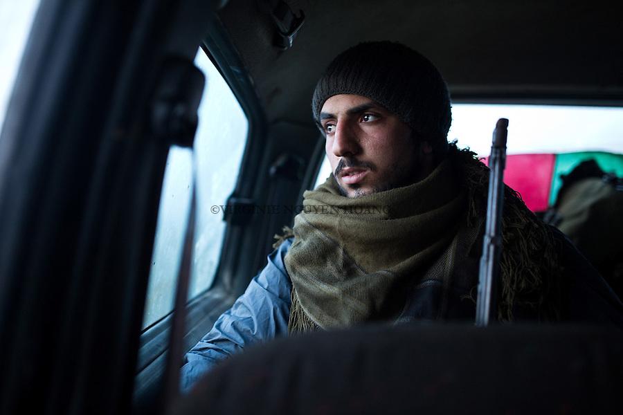 A: A YPG fighter goes back to another based on a village near the town of Tal Abyad.<br /> <br /> SYRIA: Un combattant YPG se rend &agrave; une autre base arri&egrave;re d'un village pr&egrave;s de la ville de Tal Abyad.