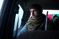 A: A YPG fighter goes back to another based on a village near the town of Tal Abyad.<br /> <br /> SYRIA: Un combattant YPG se rend à une autre base arrière d'un village près de la ville de Tal Abyad.