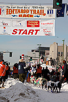 Musher Hugh Neff and Iditarider The Cat in the Hat.leave the 2011 Iditarod ceremonial start line in downtown Anchorage, Alaska