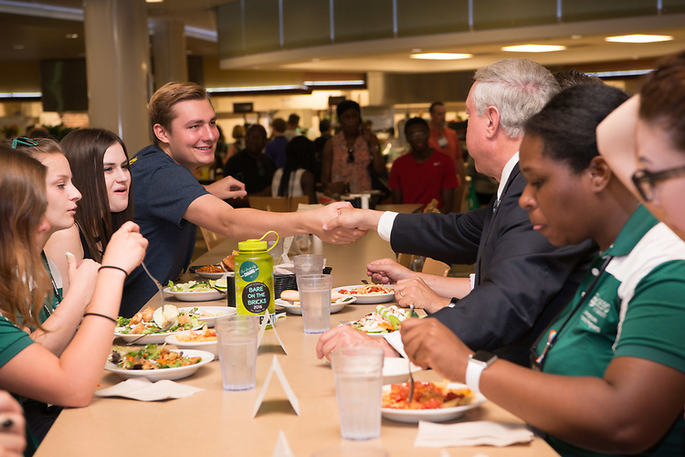 President Nellis greets students at Nelson Dining Hall on first day in office.