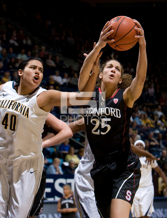 Berkeley, CA - March 4th, 2012: Erica Payne of Stanford fights for a loose ball against Justine Hartman of California during a basketball game against California in Berkeley, California.   Stanford won, 86-61.