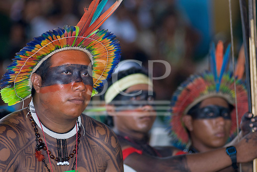 "Altamira, Brazil. ""Xingu Vivo Para Sempre"" protest meeting about the proposed Belo Monte hydroeletric dam and other dams on the Xingu river and its tributaries.Yudja chief  Yapariwa, listens to the presentation."