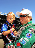 Jul. 18, 2010; Sonoma, CA, USA; NHRA funny car driver John Force holds Autumn Hight during the Fram Autolite Nationals at Infineon Raceway. Mandatory Credit: Mark J. Rebilas-