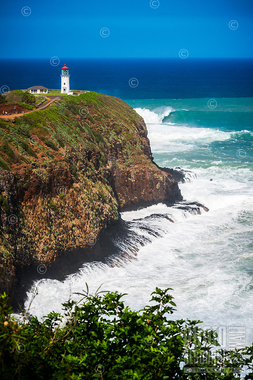 Big waves crash into the cliffs near Kilauea Lighthouse, northern Kaua'i.