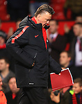 Louis Van Gaal, manager of Manchester United makes his way to the changing room with his tactics in hand - Manchester United vs. Burnley - Barclay's Premier League - Old Trafford - Manchester - 11/02/2015 Pic Philip Oldham/Sportimage