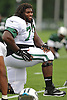 James Carpenter #77 of the New York Jets stretches during the start of a day of team training camp at Atlantic Health Jets Training Center in Florham Park, NJ on Tuesday, Aug. 2, 2016.