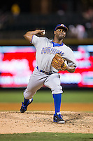 Durham Bulls relief pitcher Jhan Marinez (32) in action against the Charlotte Knights at BB&T BallPark on July 22, 2015 in Charlotte, North Carolina.  The Knights defeated the Bulls 6-4.  (Brian Westerholt/Four Seam Images)
