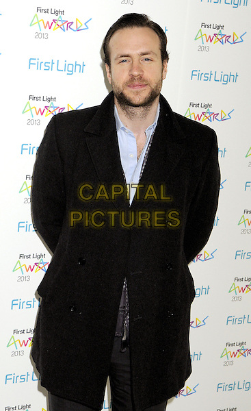 Rafe Spall .attended the First Light Awards 2013, Odeon Leicester Square cinema, Leicester Square, London, England..March 19th, 2013.half length black jacket blue shirt beard facial hair .CAP/PP/BK.©Bob Kent/PP/Capital Pictures