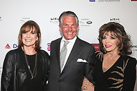 BEVERLY HILLS, CA - NOVEMBER 7: Linda Gray, George Hamilton and Joan Collins at the Mark Zunino Atelier Fashion and Cocktail Reception to benefit the Elizabeth Taylor Foundation hosted by Dame Joan Collins on November 7, 2019.        <br /> CAP/MPI/SAD<br /> ©SAD/MPI/Capital Pictures