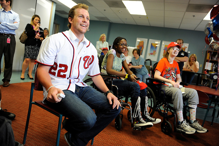 UNITED STATES - AUGUST 19:  Drew Storen, Washington Nationals relief pitcher, plays a bowling game on Nintendo Wii with Delaney O'Hagan, 16, right, and Tervian Litchmore, 17, in the pediatric unit at the National Rehabilitation Hospital.  Storen visited the facility to participate in activities which are often used in patient's rehabilitation.(Photo By Tom Williams/Roll Call)