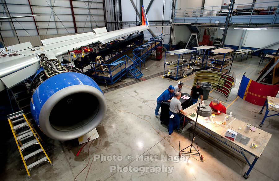 A Southwest Airlines maintenance crew next to a plane under repair at  the Southwest Airlines  maintenance center near Love Field Airport in Dallas, Texas, Wednesday, October 27, 2010...PHOTO/ MATT NAGER