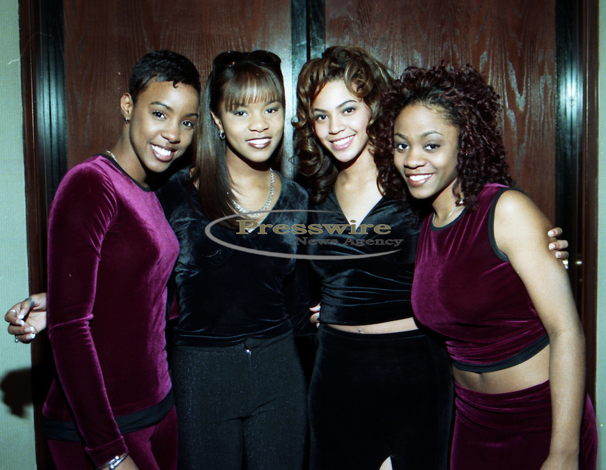 Destiny's Chile ORIGINAL GROUP pictured from L-R: Kelly Rowland, Leoya Lucett, Beoynce Knowles & LaTavia Roberson at the K104 Christmas party at the Hyatt Regency in downtown Dallas, Texas on December 15, 1997 prior to their first record coming out.  Photo credit: Presswire News/Elgin Edmonds