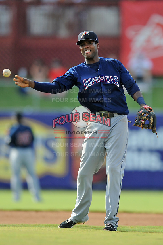 Huntsville Stars shortstop Hector Gomez #4 throws to first during game one of a double header against the Tennessee Smokies at Smokies Park on July 8, 2013 in Kodak, Tennessee. The Stars won the game 2-0. (Tony Farlow/Four Seam Images)