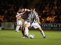 Paul McGowan holds off James Keatings in the St Mirren v Hamilton Academical Scottish Communities League Cup match played at St Mirren Park, Paisley on 25.9.12.
